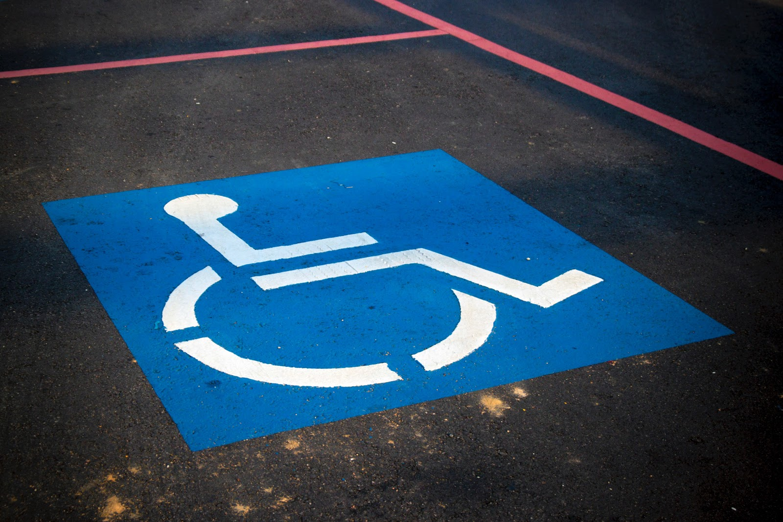 accessible logo on a parking spot